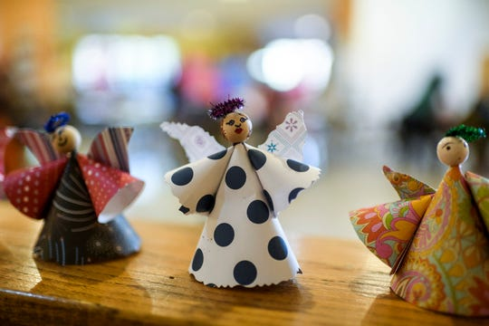 Decorative handmade Angels are displayed during the Christmas Extravaganza party at Patchwork Central in Evansville, Thursday evening, Dec. 5, 2019. The angels were created by children attending the after school Arts & Smarts program that is held at the community center.