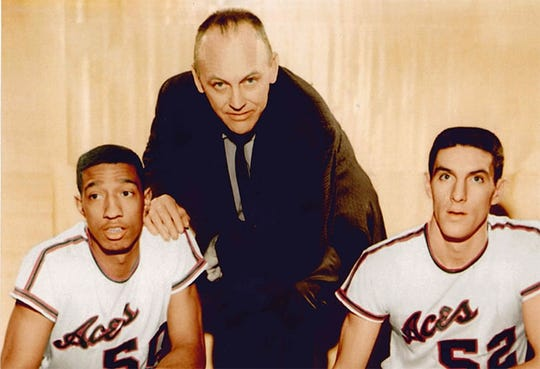Humes (left) poses with Evansville head coach Arad McCutcheon and teammate Jerry Sloan.