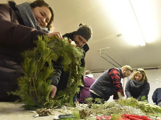 Celia Mokrzycki, left, and Andy Mach, both of Kenosha, create a wreath at last year's Natural Christmas at The Ridges Sanctuary in Baileys Harbor. This year's Natural Christmas takes place Dec. 11.