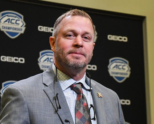 Virginia Head Coach Bronco Mendenhall listens to a question during the ACC football championship pregame press conference at Bank of America Stadium in Charlotte, North Carolina Friday, December 6, 2019.