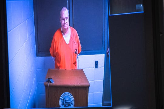 Dennis Slaton appears on a monitor at the Greenville County Courthouse for his bond hearing, Friday, December 6, 2019.