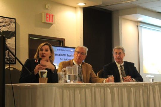 Panelist at the Grain Growers forum on trade included trade policy expert Angela Marshall Hoffman, left, BNSF executive Greg Guthrie, center, and U.S. agriculture undersecretary Ted McKinney, right.
