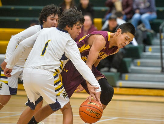 Box Elder's Gabe Saddler attempts to steal the ball from Rocky Boy's Blake Cantrell during Friday's basketball game at the 2019 Native American Basketball Classic in the CMR Fieldhouse.