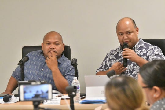Guam Education Board Chairman Mark Mendiola, left, absorbs a dialogue between Guam DOE Superintendent Jon Fernandez, right, and a member of the board at its regular meeting Dec. 6 in Tiyan.