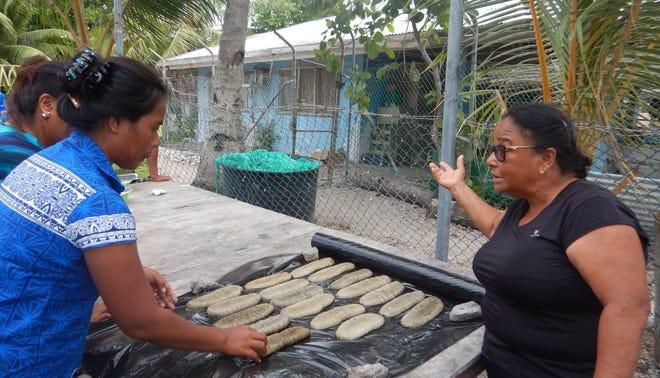 Sandfish processing in Kiribati.