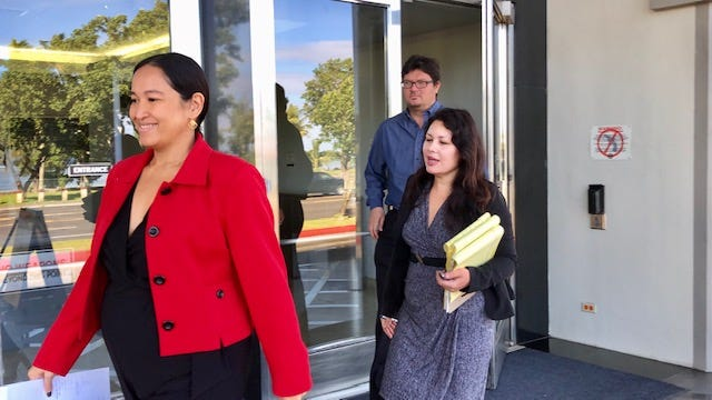Attorney Jacqueline Terlaje, left, counsel for former Archbishop Anthony Apuron, and Guam clergy sex abuse survivors' attorneys Delia Lujan Wolff and Anthony Perez exit the U.S. District Court building on Dec. 6, 2019 after a joint status hearing on clergy abuse cases.