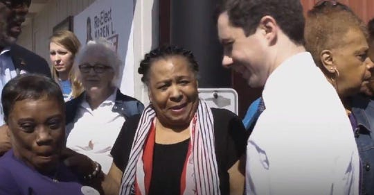"""Gladys Muhammad, center, stands with Democratic presidential candidate Pete Buttigieg in a screen capture from a video his campaign released Thursday as part of a series titled """"South Bend Stories."""""""