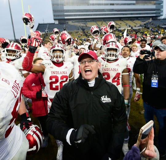Nov 30, 2019; West Lafayette, IN, USA; Indiana Hoosiers head coach Tom Allen celebrates with his team after winning the Old Oaken Bucket  defeating the Purdue Boilermakers, 44-41, in 2 OT at Ross-Ade Stadium. Mandatory Credit: Thomas J. Russo-USA TODAY Sports