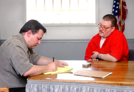 Indianapolis Star reporter Vic Ryckaert, left, interviews Death Row inmate Gregory Scott Johnson, 40, at the Indiana State Prison in Michigan City on Tuesday, May 10, 2005.