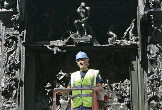 "A bronze version of ""The Gates of Hell"" by Auguste Rodin was delivered to the Royal Academy in London in 2006. ""The Thinker,"" which is above the worker, is central to the piece."