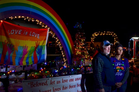 """Dwight Tittle and his wife Robbie Tittle talk about their """"Love is Love"""" float before the start of the Union City Christmas Parade."""