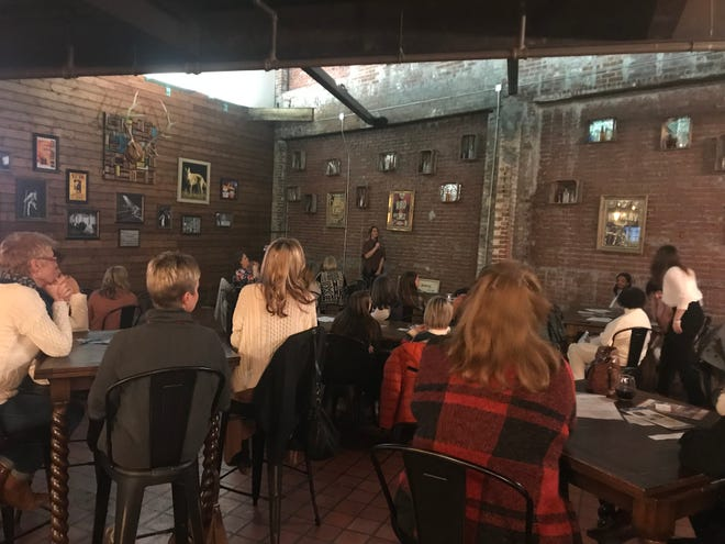 Those gathered at 100 Women Who Care Jackson's meeting at Hub City Brewery on Tuesday listen to coordinator Shelby Matthis introduce one of the speakers who discussed their organization.