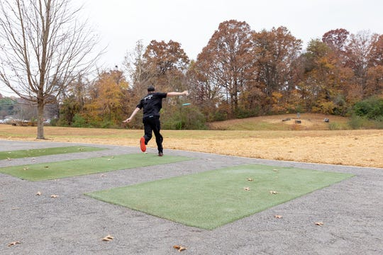 Tennessee disc golf professional Chris Dickerson takes the first throw on The Claytons course to mark the grand reopening.