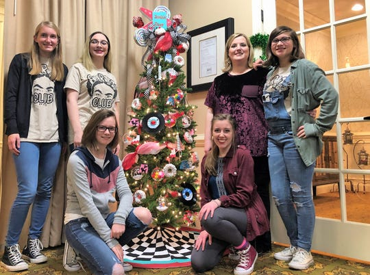 "Halls High Art Club presents its Christmas Tree to Morning Pointe of Powell assisted living center. ""We try to give back to the community, not just the school,"" said art club sponsor Elizabeth Lynch. Pictured from left: Madison Ortner, Maddy Brandon, Jaiden Hubble, Gracie Richmond, Lily Brown with Lynch on Dec. 5, 2019."