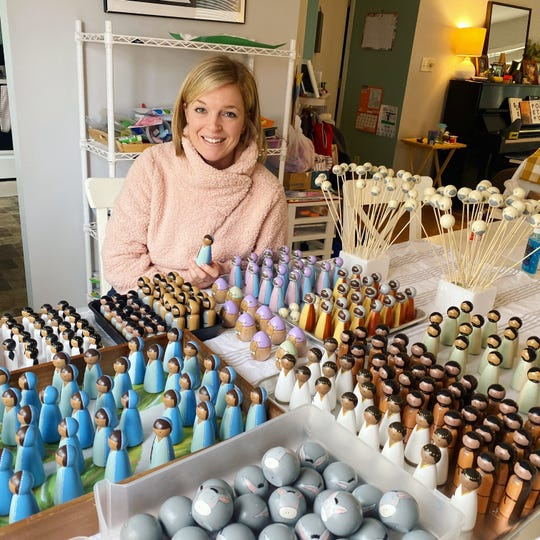 Hannah Kline pictured with figures for her Nativity sets.