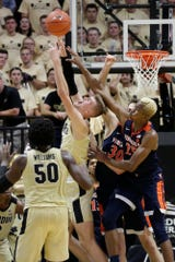 Purdue center Matt Haarms (32) goes up for the rebound against Virginia forward Jay Huff (30) and Virginia forward Mamadi Diakite (25) during the second half of an NCAA men's basketball game, Wednesday, Dec. 4, 2019 at Mackey Arena in West Lafayette.
