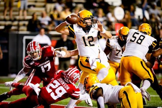 Appalachian State quarterback Zac Thomas is a concern for UL's Brenndan Johnson (29) and the Ragin' Cajuns in Saturday's Sun Belt Conference championship game.