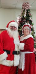Santa Allen Guidry and Mrs. Clause
