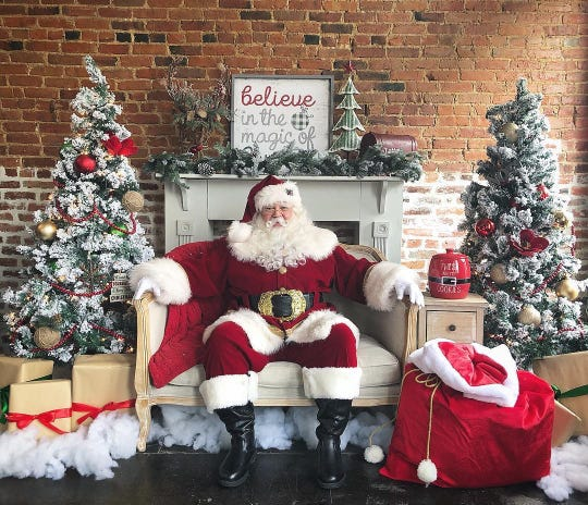 Santa Cody Short waits for children to take photos and hear requests for gifts.
