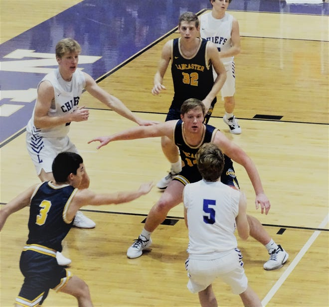 Lancaster's Owen Snyder defends a Logan player during a recent game. Snyder has excelled at basketball and football and carries a 4.68 GPA.
