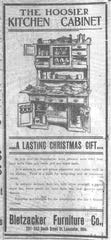 A Santa Claus wagon from the Bletzacker Furniture Co. was delivering gifts such as this Hoosier kitchen cabinet to homes before Christmas in 1905. Ad appeared in the Gazette 20 Dec. 1905.