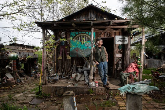 Cecil Ison stands on the porch of the Curetorium, a small structure at the Home for Wayward Babydolls. April 19, 2019