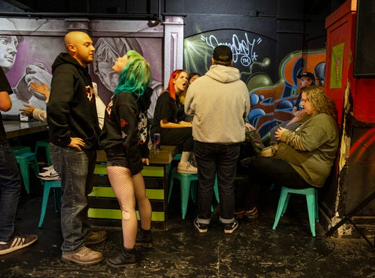 Fans of straight edge and hardcore punk music talk while waiting for bands to play at Spinelli's Pizza. Oct. 24, 2019.