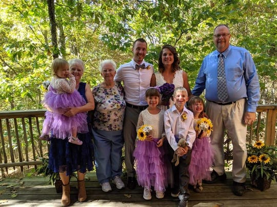 Matt Peterson (center), once homeless, is surrounded by his family during his October, 2019 wedding. From left to right, his mother Cheryl Peterson, his daughter, Marley, 2; grandmother, Louise Sebastian; Matt; his wife, Megan McDonald-Peterson; his children, Myla, 6, Christian, 7, and Riley, 5; and his father, Paul Peterson. (Photo courtesy of Mackenzie Masters).