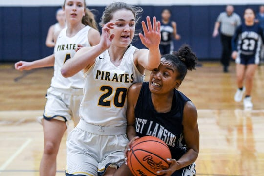 East Lansing's Sanaya Gregory, right, is fouled by Pewamo-Westphalia's Makayla Hengesbach during the fourth quarter on Dec. 5, 2019, in Westphalia. P-W and East Lansing were both ranked No. 1 in their divisions and were competing for regional titles when the MHSAA suspended winter sports action due to the coronavirus.