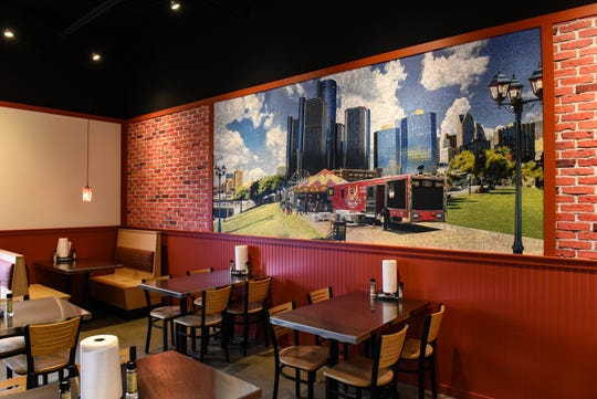 A mural inside Smoke 'N Pig BBQ new brick and mortar restaurant in Delta Township.