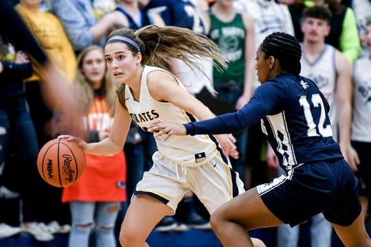 Pewamo-Westphalia's Ellie Droste, left, moves with the ball as East Lansing's Bre'Naya Lane defends during the second quarter on Thursday, Dec. 5, 2019, in Westphalia.