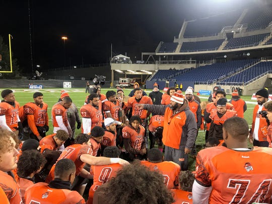 Mansfield Senior coach Chioke Bradley huddles with his team after the Tygers fall 14-7 in overtime to Trotwood-Madison in the Division III state championship game.