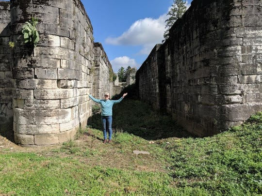 Author Karen Robertson poses with the canal locks in the small Ohio town of Lockington.