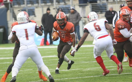 Mansfield Senior's Angelo Grose looks for running room in the first half of Friday's Division III state championship game against Trotwood-Madison.