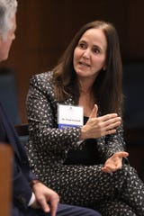 Dana Suskind, a University of Chicago surgeon, speaks with Marquette Law fellow Mike Gousha during a conference on early childhood development on Wednesday.