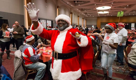 Robert Boyd appears as Santa at the Salvation Army Christmas Family Feast on Dec. 25, 2016 at the Wisconsin Center in Milwaukee. Boyd has made his Santa Claus visits a family event, with his wife Sarhena as Mrs. Claus and their children as elves.