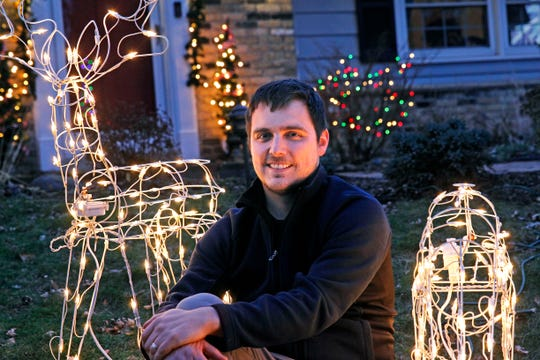 Mike Walczak sits outside his Wauwatosa home on Thursday, Dec. 5. For the last three years, Walczak has set up his outdoor holiday lights display to be controlled via a website. Anyone can use it.