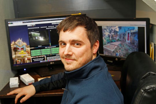Mike Walczak uses three computers and servers so his interactive holiday lights operation can run smoothly.