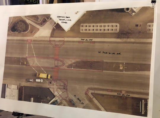 Proposed changes to West North Fond du Lac Avenue at North 38th Street include extending the medians and bumping the curbs out into the parking lane, as well as painting thick stripes on the road to denote the crosswalk.
