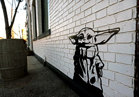Artist Michael Cerda painted a baby Yoda onto Hotel Madrid in Walker's Point.