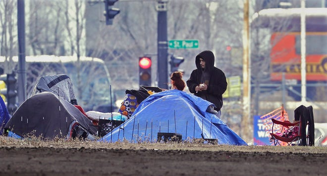 State and local officials say they're working to prevent the return of a homeless camp to land beneath I-794.