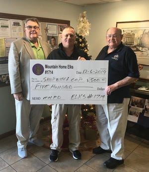 "The Mountain Home Elks lodge #1714 recently presented a $500 check to the Mountain Home Fraternal Order of Police Lodge #45 to assist with the FOP ""Shop with a Cop"" event to provide gifts for 95 underprivileged children. Shown are (from left) Chris Robinson, Elks Benevolence chairman; Sgt. Eddie Helmert, FOP Treasure and Stuart Friend, Elks president."
