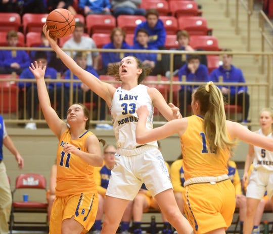 Mountain Home's Anna Grace Foreman reels in one of her 16 rebounds against Bolivar, Mo., on Thursday night at the Branson tournament.