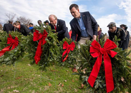 Montgomery County District Attorney Daryl Bailey and Judge Jimmy Poole take part as the Annual Christmas Wreath Laying in memory of Fallen MPD Officers is held on Friday December 6, 2019 at King Hill Park along Upper Wetumpka Road in Montgomery, Ala., where plaques have been placed honoring each fallen officer.