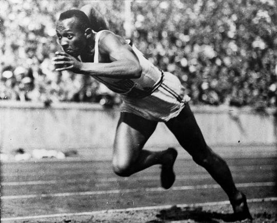 Jesse Owens competes at the 1936 Summer Olympics in Berlin.