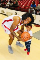 Alabama junior wing John Petty Jr. and his daughter, Aubrielle, take a picture after a recent Crimson Tide basketball game inside Coleman Coliseum in Tuscaloosa (Courtesy Photo)