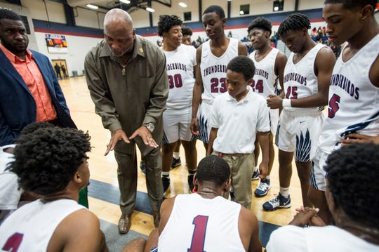 Park Crossing coach Vincent Royals talks with his team during a break in the action at Park Crossing High School in Montgomery, Ala., on Thursday, Dec. 5, 2019.