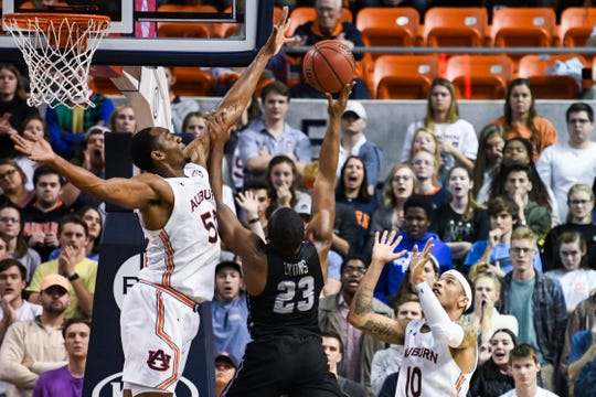 Auburn center Austin Wiley (50) blocks a shot by Furman guard Jordan Lyons (23) during overtime of an NCAA college basketball game Thursday, Dec. 5, 2019, in Auburn, Ala. (AP Photo/Julie Bennett)