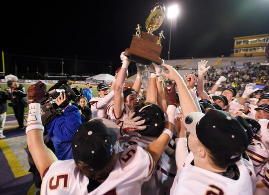 ECS celebrates after beating CPA in the Division II-AA high school football championships at Tucker Stadium in Cookeville, Tenn., Thursday, Dec. 5, 2019.