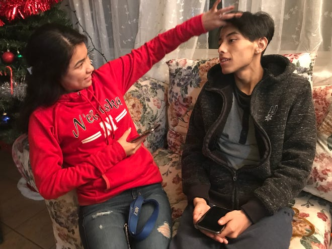 """Melissa Matinez, 23, teases her cousin Josue Nandho, 16, that his hair looks like Justin Bieber's. The two hang out often because their """"personalities match."""" Nandho was diagnosed with terminal liver cancer just four months ago. """"I live every day like normal,"""" he said."""